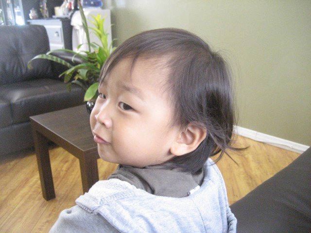 His mullet before the hair cut